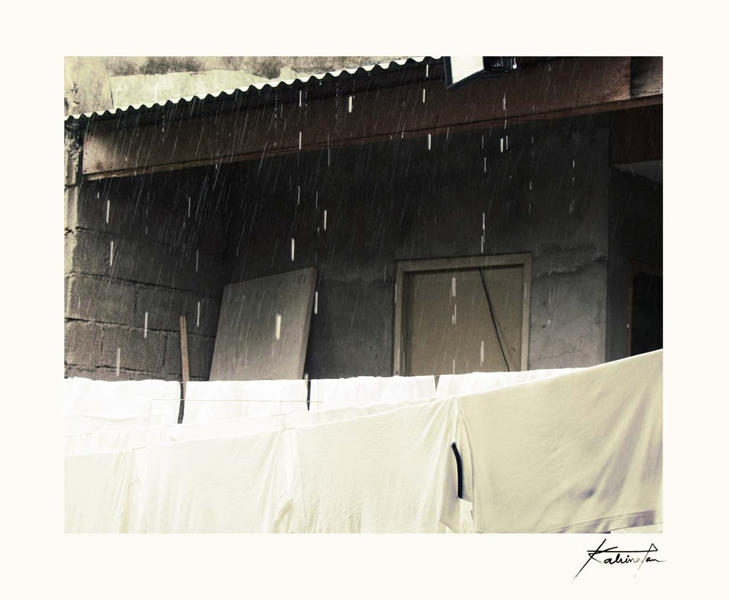 laundry in the rain © 2007 by eunoia@deviantart.com